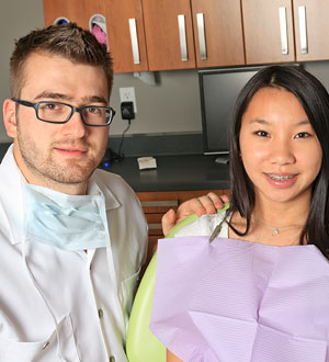 an image of a dentist and a female patient